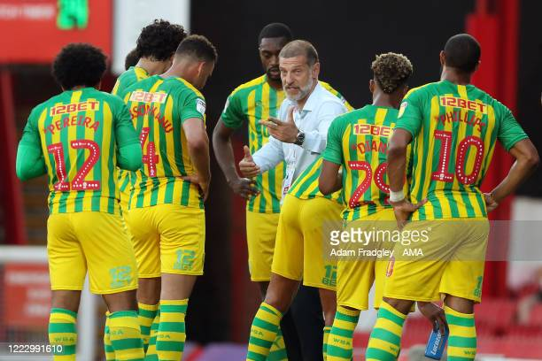 Slaven Bilic head coach / manager of West Bromwich Albion speaks to his players during the first half drinks break during the Sky Bet Championship...