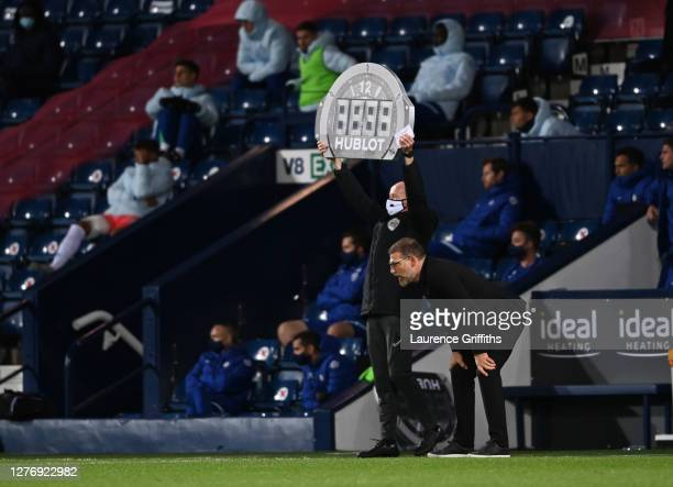 Slaven Bilic Hwead Coach of West Bromwich Albion looks on as the Fourth Official holds up the Hublot Board during the Premier League match between...
