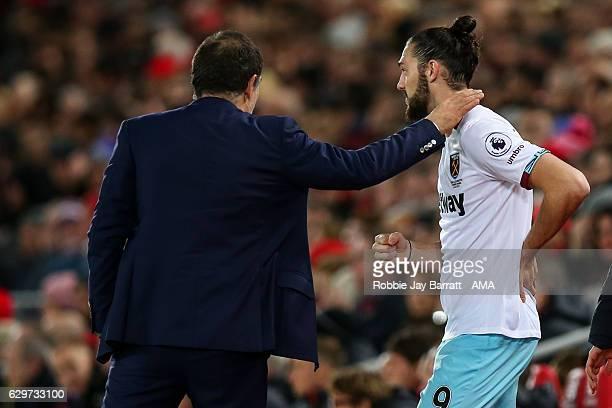 Slaven Bilic manager / head coach of West Ham United and Andy Carroll of West Ham United during the Premier League match between Liverpool and West...