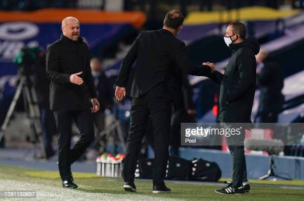 Slaven Bilic Manager of West Bromwich Albion and Sean Dyche Manager of Burnley interact with the Fourth Official Kevin Friend at fulltime after the...