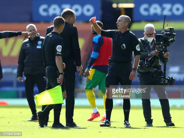 Slaven Bilic, Manager of West Bromwich Albion is shown the red card by match referee Mike Dean during the Premier League match between Everton and...