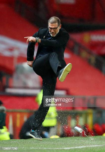 Slaven Bilic, Manager of West Bromwich Albion kicks a drinks can as he reacts during the Premier League match between Manchester United and West...