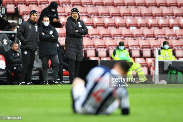 Slaven Bilic manager of West Bromwich Albion looks on as Hal RobsonKanu of West Bromwich Albion reacts with an injury during the Premier League match...