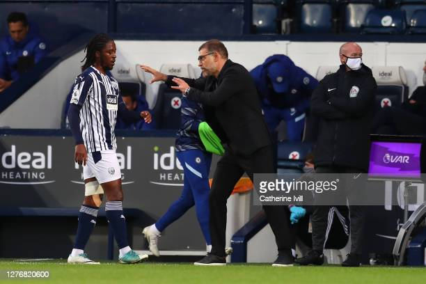Slaven Bilic Manager of West Bromwich Albion talks to Romaine Sawyers of West Bromwich Albion during the Premier League match between West Bromwich...