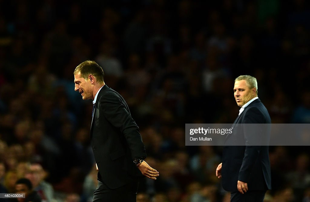 Slaven Bilic, Manager of West Ham (L) is sent to the stands by Referee, Adrien Jaccottet as Marius Sumudica, Manager of Astra Giurgiu looks on during the UEFA Europa League third qualifying round match between West Ham United and Astra Giurgiu at the Boleyn Ground on July 30, 2015 in London, England.