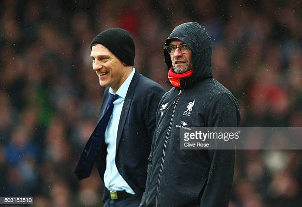 Slaven Bilic manager of West Ham United and Jurgen Klopp manager of Liverpool are seen during the Barclays Premier League match between West Ham...
