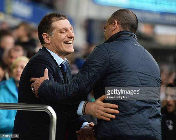 Slaven Bilic manager of West Ham United and Roberto Martinez Manager of Everton greet prior to the Barclays Premier League match between Everton and...