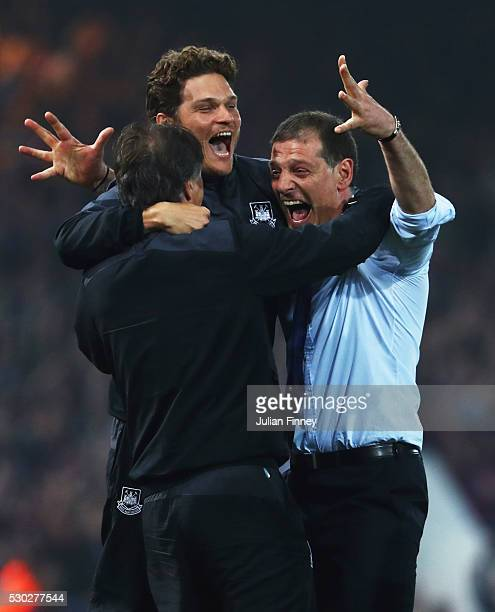 Slaven Bilic manager of West Ham United celebrates victory with staff after the Barclays Premier League match between West Ham United and Manchester...