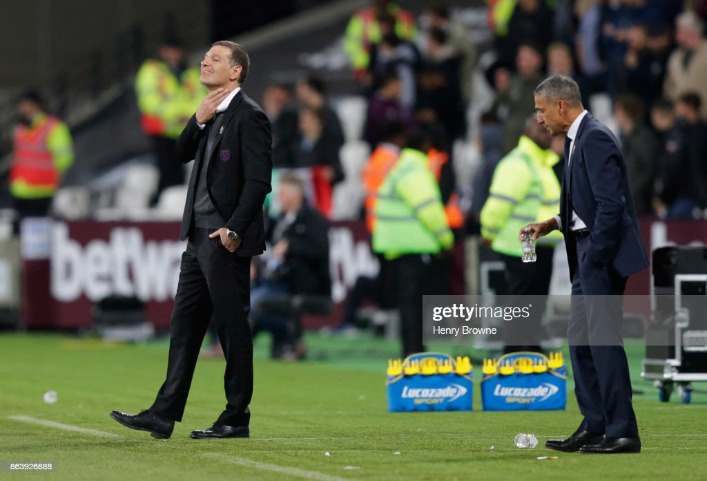 Slaven Bilic, Manager of West Ham United reacts as Chris Hughton, Manager of Brighton and Hove Albion looks on during the Premier League match between West Ham United and Brighton and Hove Albion at London Stadium on October 20, 2017 in London, England.