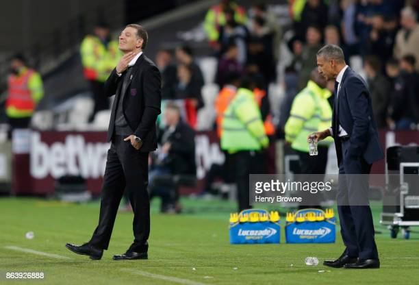 Slaven Bilic Manager of West Ham United reacts as Chris Hughton Manager of Brighton and Hove Albion looks on during the Premier League match between...