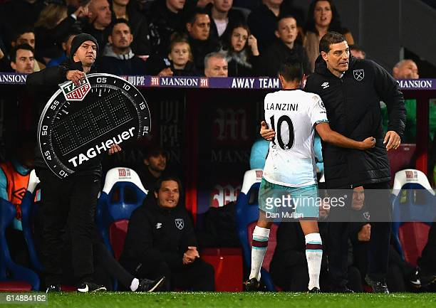 Slaven Bilic manager of West Ham United shakes hands with Manuel Lanzini of West Ham United as he is substituted during the Premier League match...