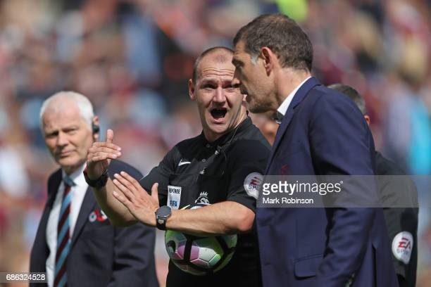 Slaven Bilic Manager of West Ham United speaks to Bobby Madley match referee at half time during the Premier League match between Burnley and West...