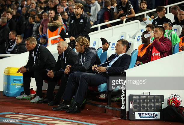 Slaven Bilic, manager of West Ham United takes his seat with Chris Woods , Julian Dicks and Edin Terzic during the Barclays Premier League match...