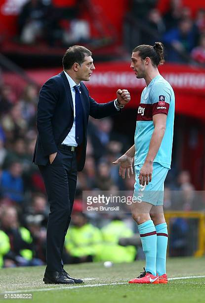 Slaven Bilic manager of West Ham United talks to Andy Carroll of West Ham United during the Emirates FA Cup sixth round match between Manchester...