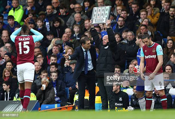 Slaven Bilic manager of West Ham United talks to the fourth official while Andy Carroll of West Ham United replaces Diafra Sakho during the Barclays...