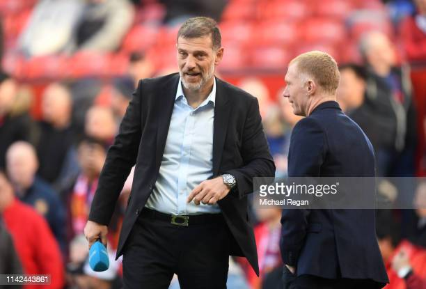 Slaven Bilic speaks to Paul Scholes prior to the Premier League match between Manchester United and West Ham United at Old Trafford on April 13, 2019...