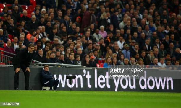 Slaven Bilic the head coach / manager of West Ham United stands next to an advert saying won't let you down during the Carabao Cup Fourth Round match...