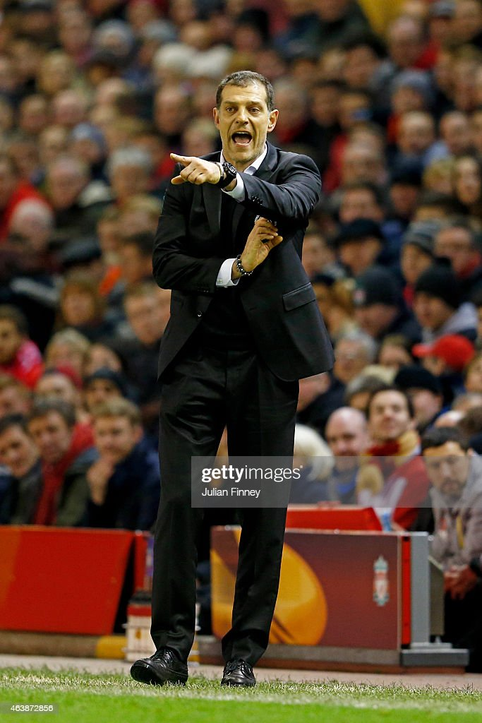 Slaven Bilic the manager of Besiktas gestures during the UEFA Europa League Round of 32 match between Liverpool FC and Besiktas JK at Anfield on February 19, 2015 in Liverpool, United Kingdom.