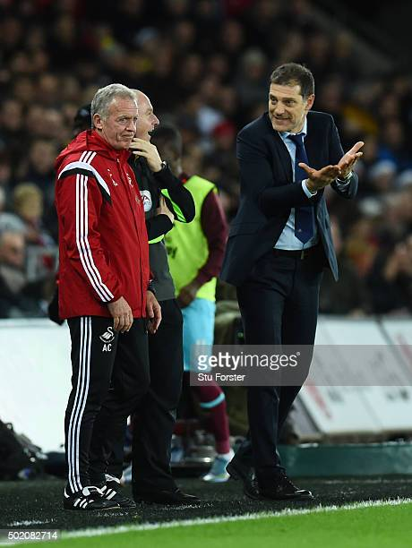 Slaven Bilic the manager of West Ham gestures towards Alan Curtis the caretaker manager of Swansea City during the Barclays Premier League match...