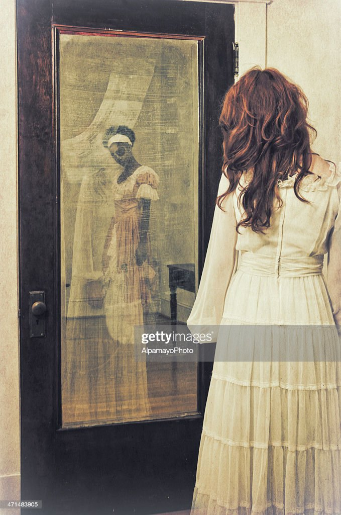 Slave's ghostly reflection in the mirror - II : Stock Photo
