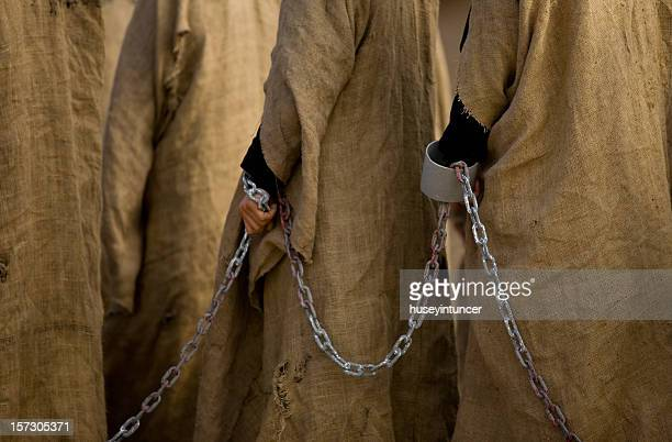 slaves - slaves in chains stock pictures, royalty-free photos & images