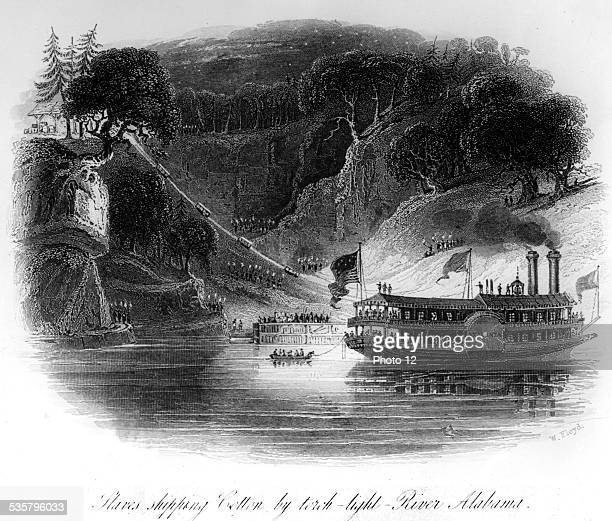 Slaves shipping cotton by torchlight on the Alabama River United States Paris National Library