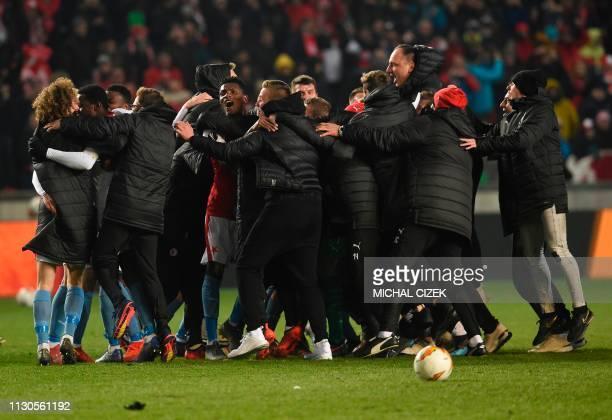 Slavia Prague celebrate after extra time of the UEFA Europa League last 16 second leg football match Slavia Prague v Sevilla on March 14 2019 in...