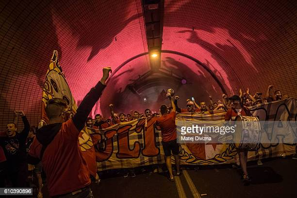 Slavia Prague fans march toward Generali Arena Stadium for the derby match against Sparta Prague through road tunnel on September 25 2016 in Prague...