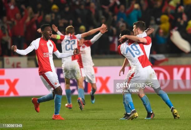 Slavia Prague players celebrate after extra time of the UEFA Europa League last 16 second leg football match Slavia Prague v Sevilla on March 14 2019...