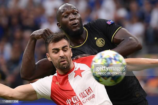 Slavia Prague's Czech defender David Hovorka and Inter Milan's Belgian forward Romelu Lukaku go for the ball during the UEFA Champions League Group F...