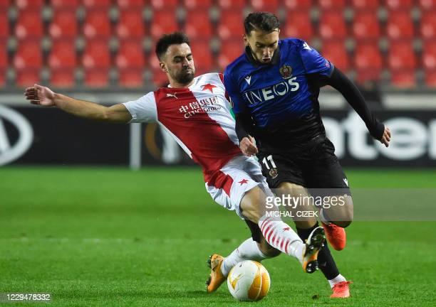 Slavia Prague's Czech defender David Hovorka and Nice's French forward Amine Gouiri vie for the ball during the UEFA Europa League Group C football...