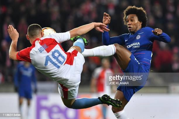 Slavia Prague's Czech defender Jan Boril and Chelsea's Brazilian midfielder Willian vie for the ball during the UEFA Europa League quarterfinal first...