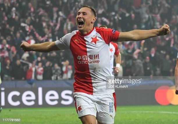 Slavia Prague's Czech defender Jan Boril celebrates after scoring the 1-1 during the UEFA Champions League football match between SK Slavia Prague...