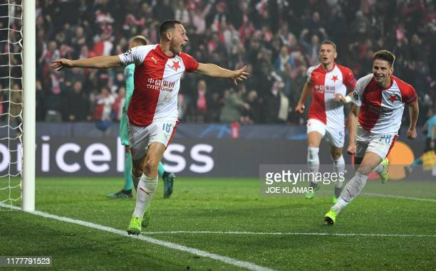 Slavia Prague's Czech defender Jan Boril celebrates with his teammates after scoring the 1-1 during the UEFA Champions League football match between...