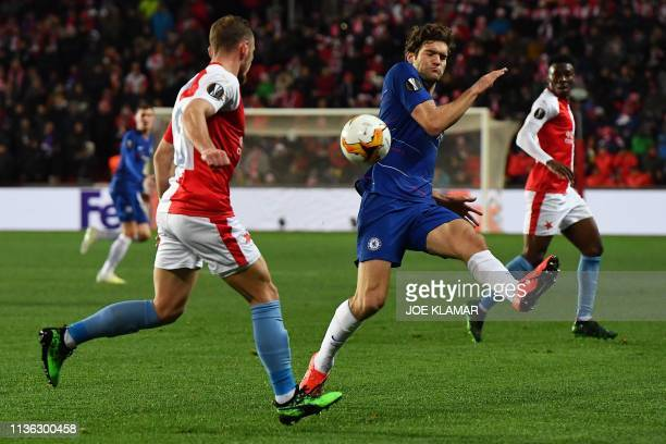 Slavia Prague's Czech defender Vladimir Coufal and Chelsea's Spanish defender Marcos Alonso vie for the ball during the UEFA Europa League...