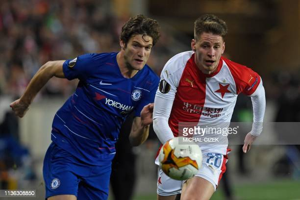 Slavia Pragues Czech midfielder Lukas Masopust and Chelseas Spanish defender Marcos Alonso vie for the ball during the UEFA Europa League...