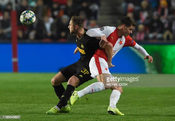 Slavia Prague's Czech midfielder Lukas Masopust and Inter Milan's Slovakian defender Milan Skriniar vie for the ball during the UEFA Champions League...