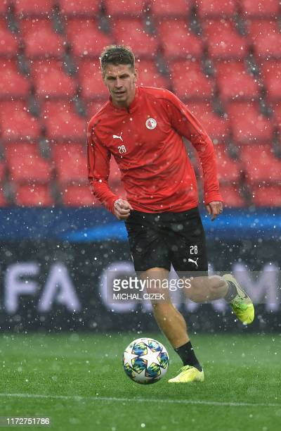 Slavia Prague's Czech midfielder Lukas Masopust takes part in a training session on the eve of the UEFA Champions League Group F football match...