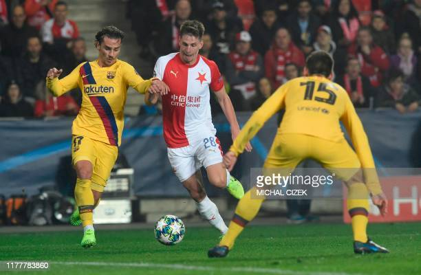Slavia Prague's Czech midfielder Lukas Masopust vies for the ball with Barcelona's French forward Antoine Griezmann and Barcelona's French defender...