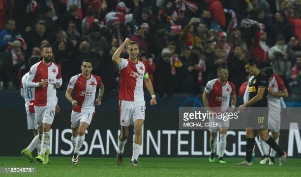 Slavia Prague's Czech midfielder Tomas Soucek celebrates scoring a penalty with his team-mates during the UEFA Champions League football match SK...