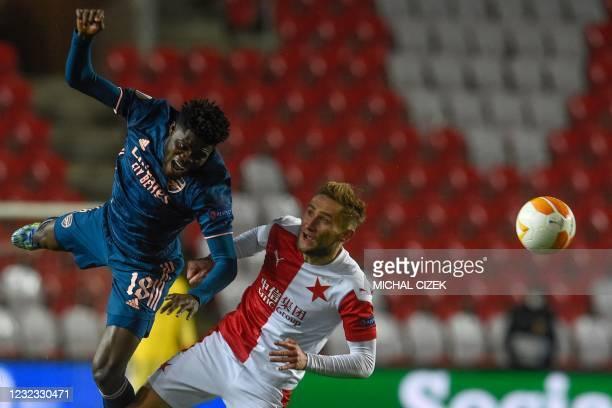 Slavia Prague's Czech striker Jan Kuchta and Arsenal's Ghanaian midfielder Thomas Partey vie for the ball during the UEFA Europa League quarter-final...