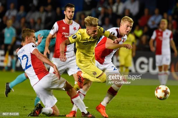 Slavia Prague's defender from Czech Republic Michal Frydrych and Slavia Prague's midfielder from Czech Republic Tomas Soucek vie with illarreal's...