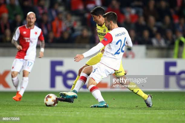 Slavia Prague's midfielder from Slovakia Jakub Hromada and Villarreal's Spanish midfielder Pablo Fornals vie for the ball during the UEFA Europa...