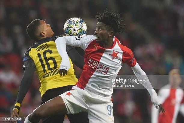 Slavia Prague's Nigerian forward Peter Olayinka and Dortmund's Swiss defender Manuel Akanji vie for the ball during the UEFA Champions League Group F...