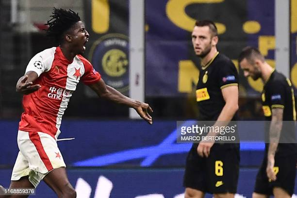 Slavia Prague's Nigerian forward Peter Olayinka celebrates after opening the scoring during the UEFA Champions League Group F football match Inter...