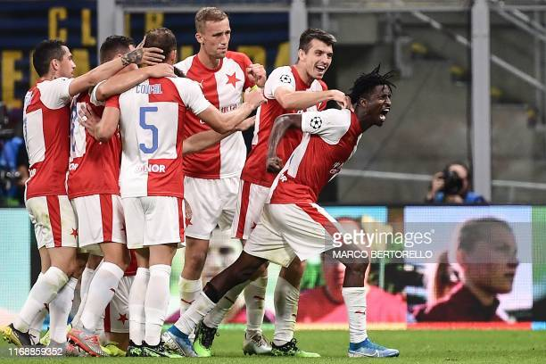 Slavia Prague's Nigerian forward Peter Olayinka celebrates with teammates after scoring during the UEFA Champions League Group F football match Inter...