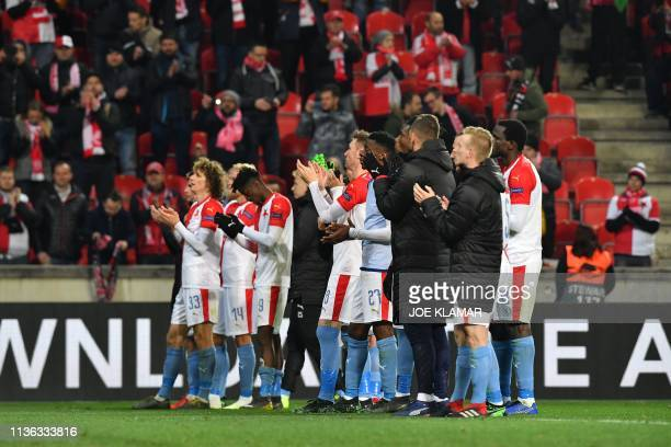 Slavia Prague's players applaud their fans after the UEFA Europa League quarterfinal first leg football match Slavia Prague v Chelsea FC in Prague on...