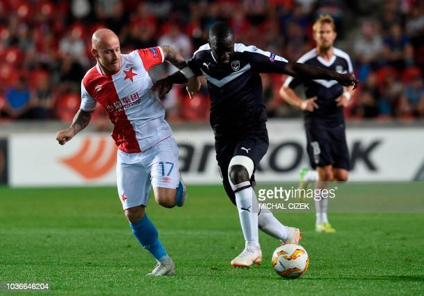 Prague's Josef Husbauer vies with Bordeaux's Jaroslav Plasil during the UEFA Europa League 1st round Group C football match between Slavia Prague and...