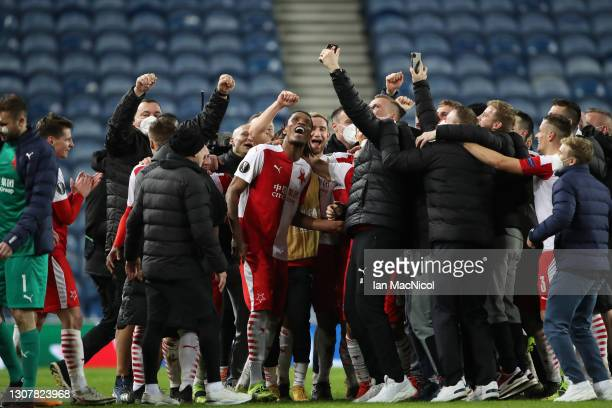 Slavia Praha players and staff celebrate victory following the UEFA Europa League Round of 16 Second Leg match between Rangers and Slavia Praha at...