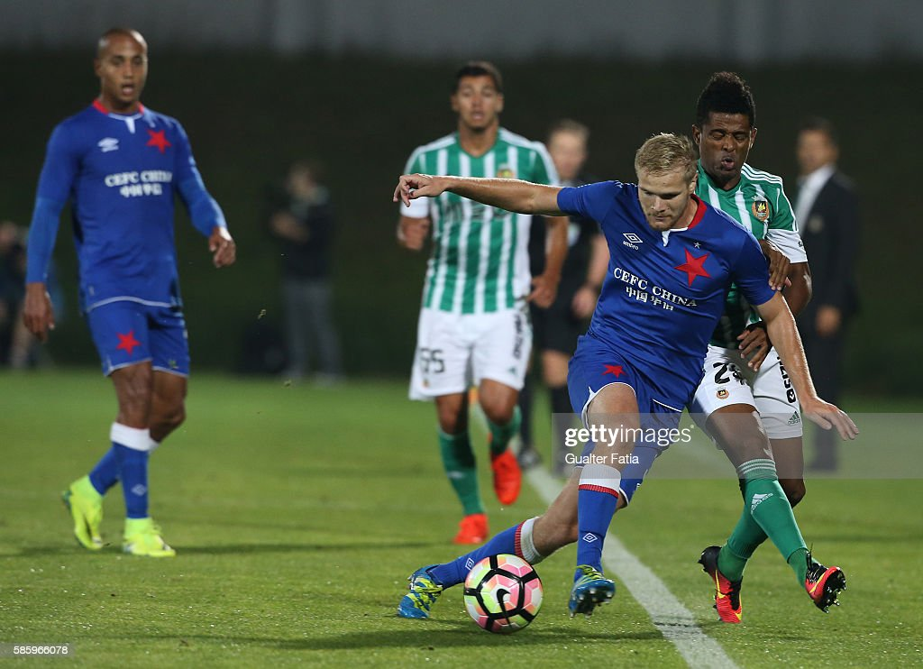 Slavia Praha's defender Jan Mikula with Rio Ave FC's forward Heldon Ramos in action during the UEFA Europa League Qualifications Semi-Finals 2nd Leg match between Rio Ave FC and Slavia Praha at Estadio dos Arcos on August 4, 2016 in Povoa de Varzim, Portugal.